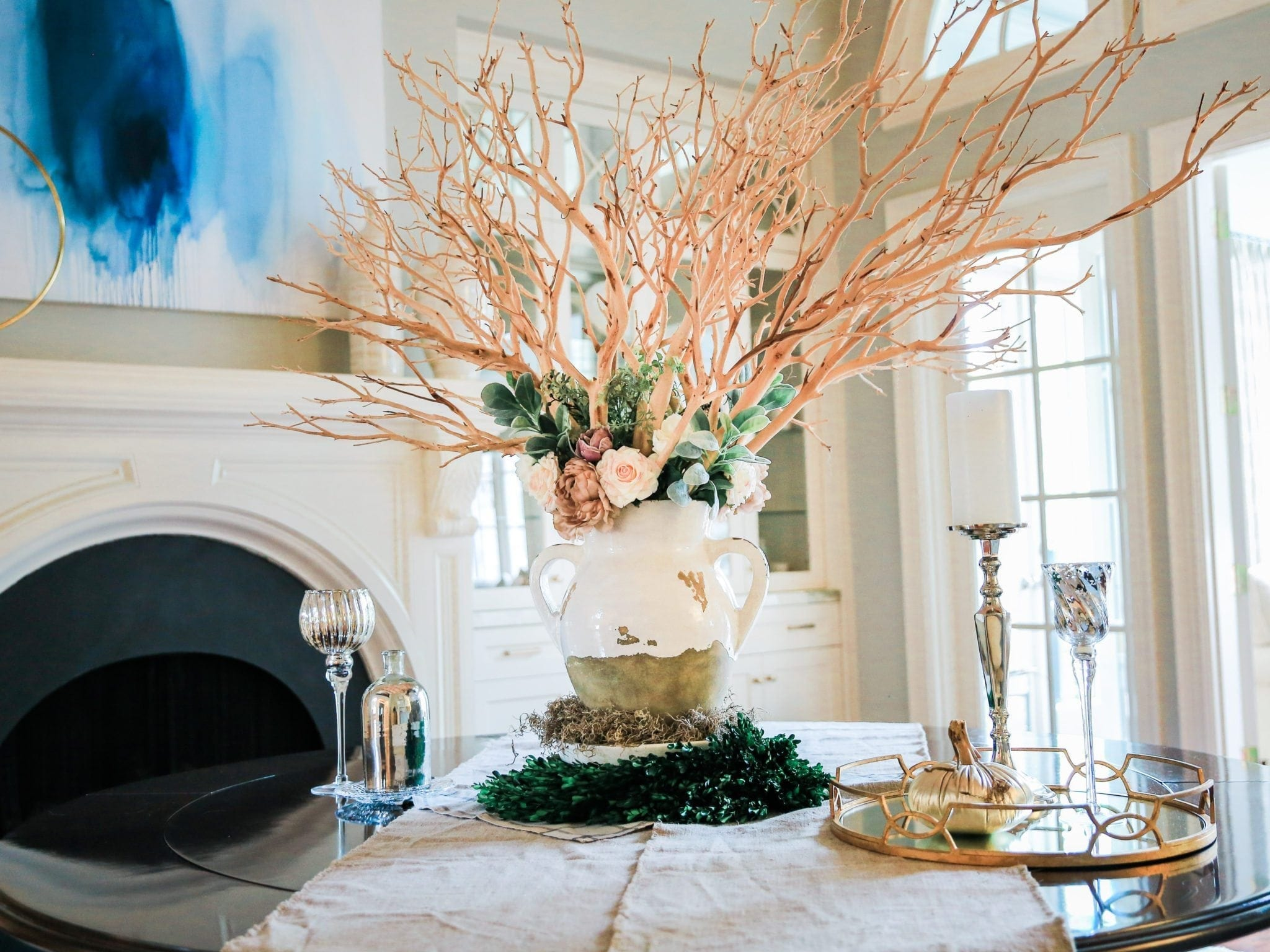 artificial real touch flowers and Pottery Barn Tuscan Urn vase in Dining room centerpiece.