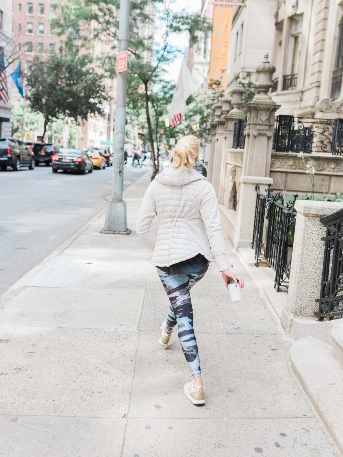 Womens Northface Jacket with Hood on cute exercise leggings for women. Camo work out leggings.