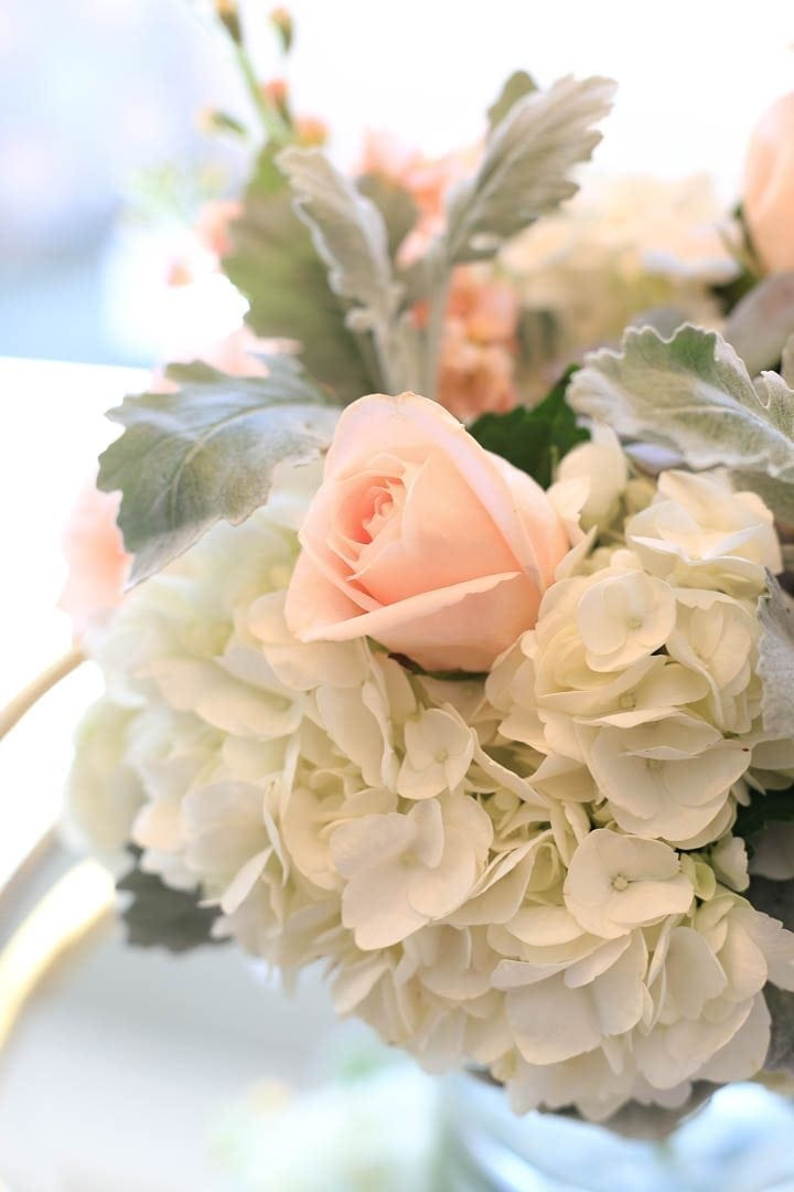 Light peach roses and dusty miller flower arrangement made by Carithers, an Atlanta florist
