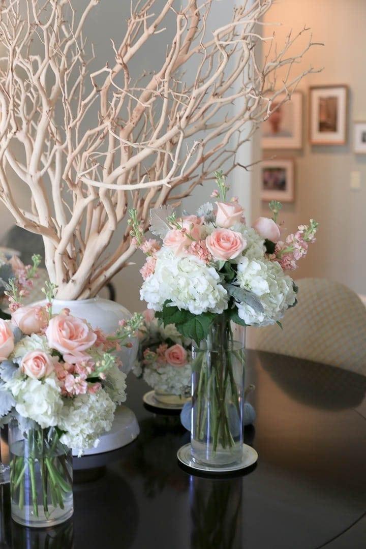 Floral display around a manzanita branch centerpiece.