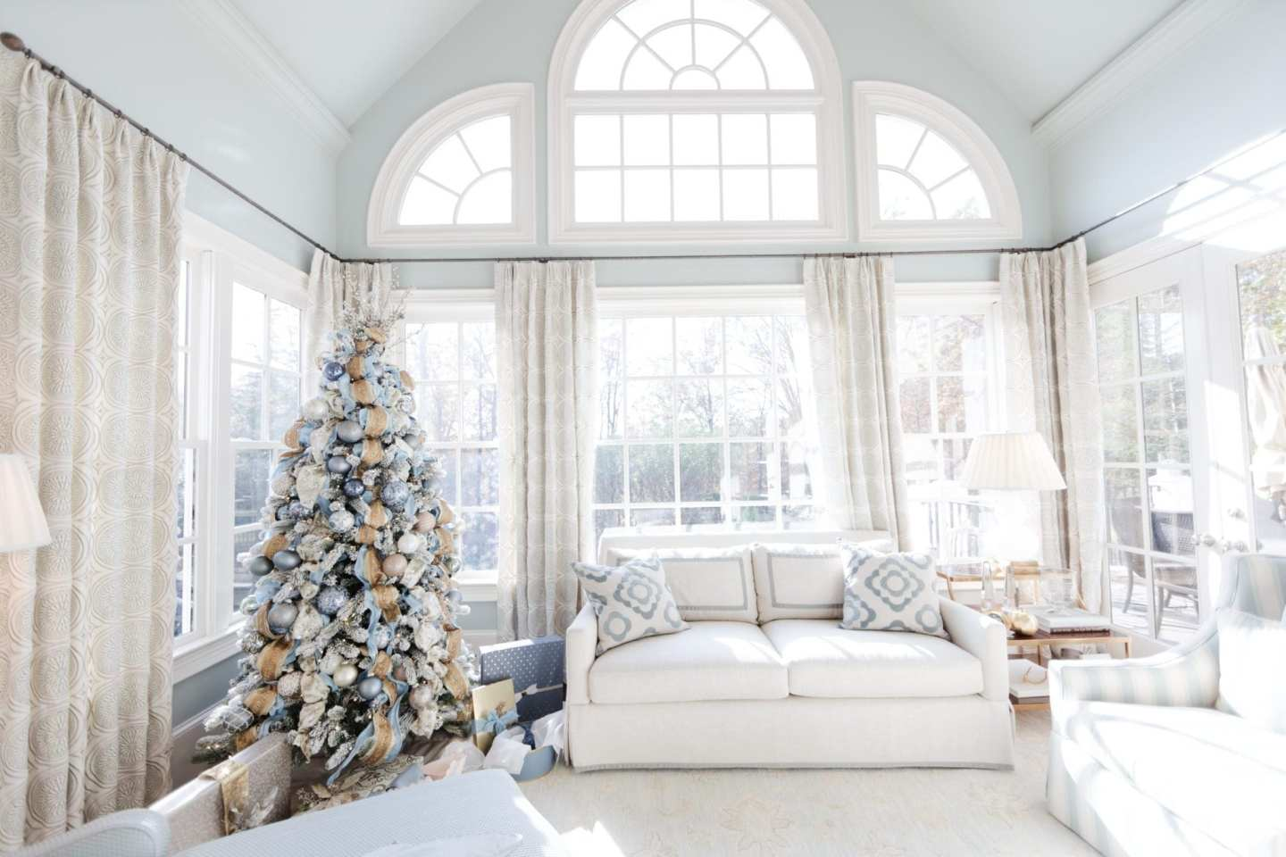 Living room designed in shades of light blue. Blue Christmas tree with Benjamin Moore Gray Wisp paint.