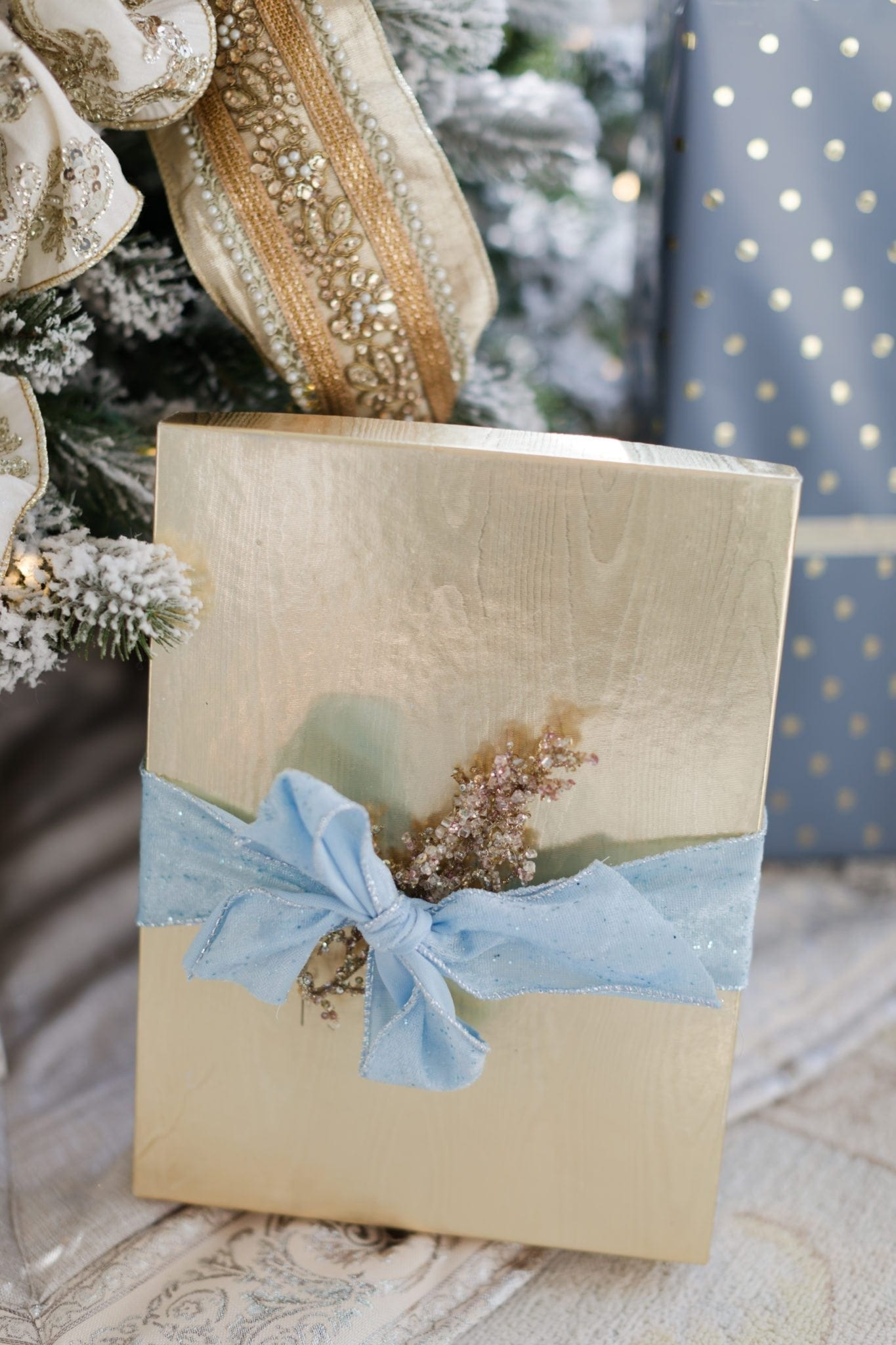 Gold box with light blue ribbon.