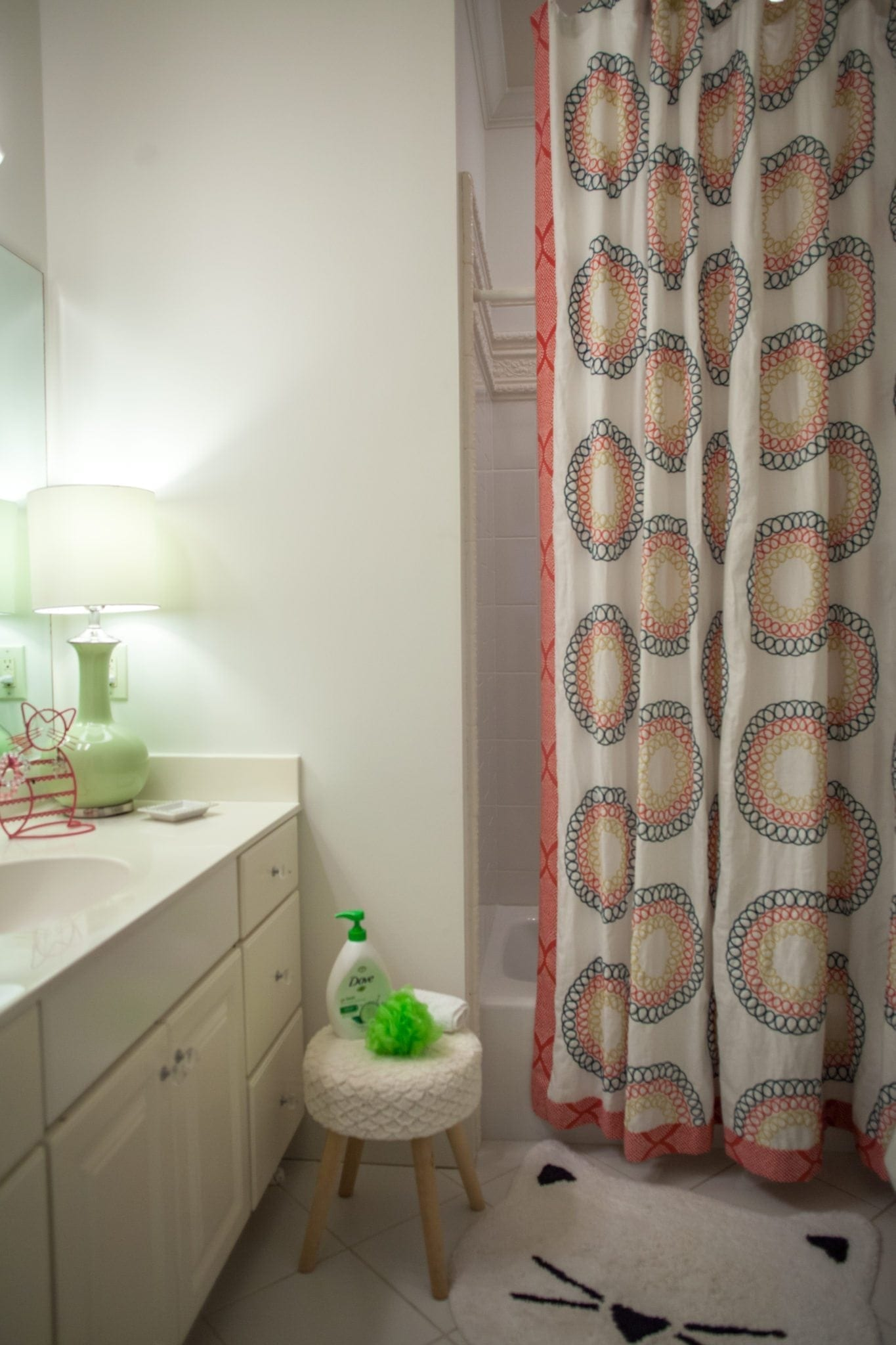Custom size shower curtains for bathrooms. Calico Corners made this fabulous shower curtain for a girls bathroom using MadCap Cottage for Robert Allen fabric. A cute white kitten bathmat from Pottery Barn is also used.
