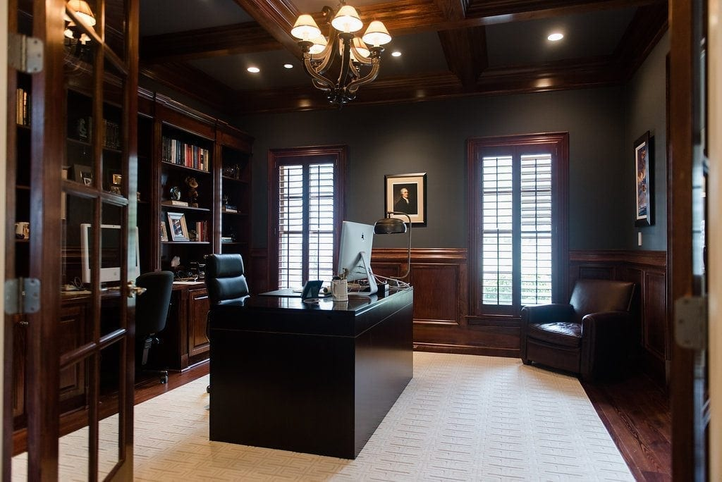 Wood Plantation Shutters stained in dark wood color.