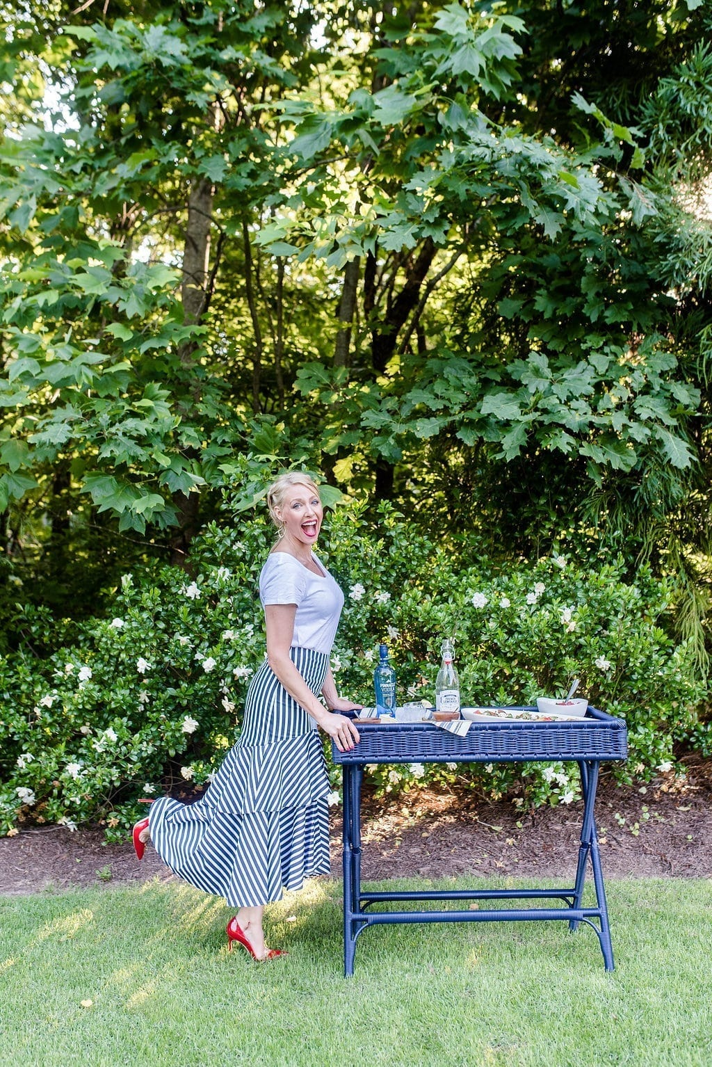 Outdoor entertaining tips from lifestyle blogger, bluegraygal. Gardenia bush and blue bar cart with Pinnacle Vodka.