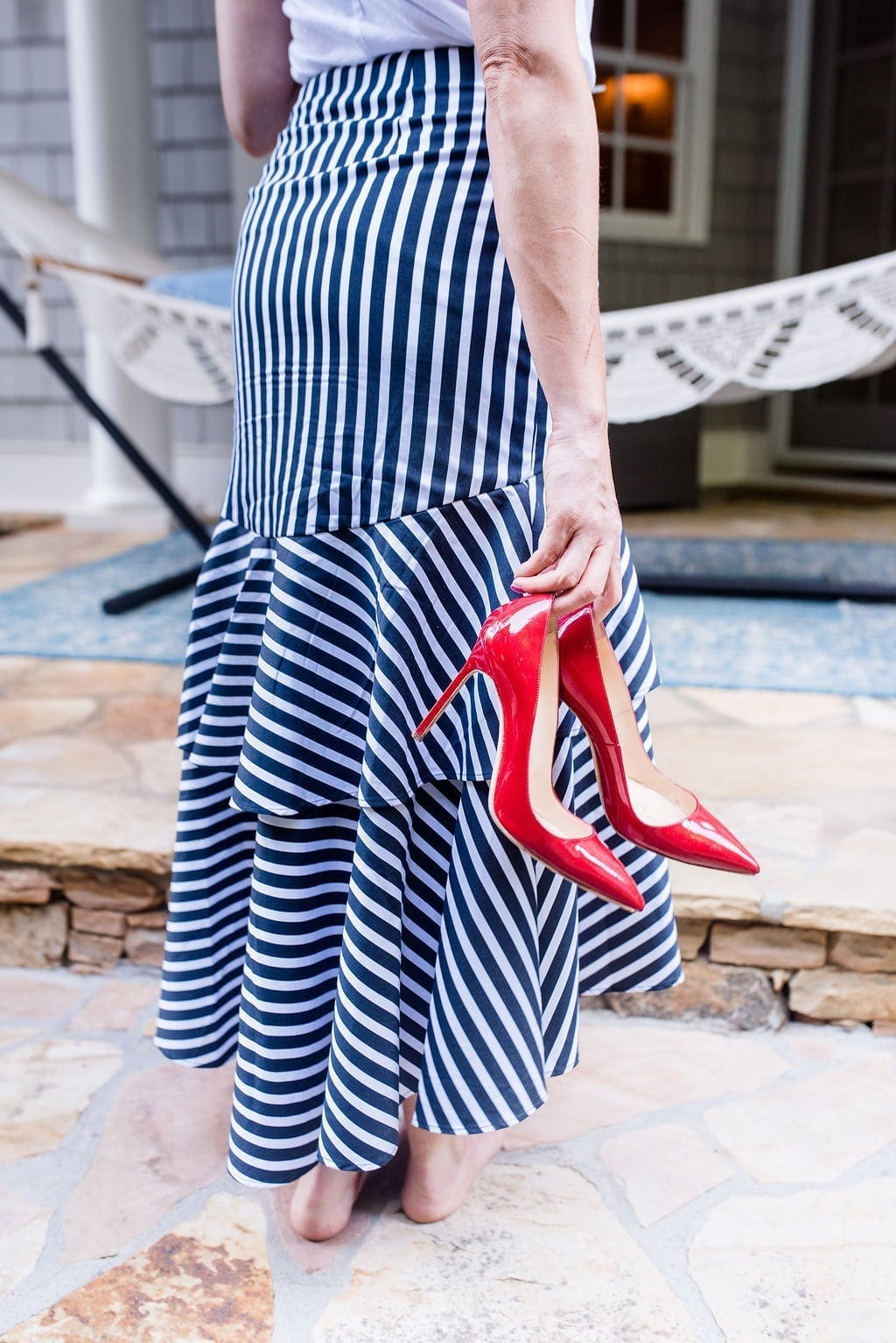 Navy and White striped skirt with red patent leather pumps.