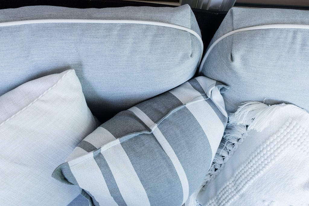 Serena and Lily pillows. Outdoor throw pillows in gray and white.