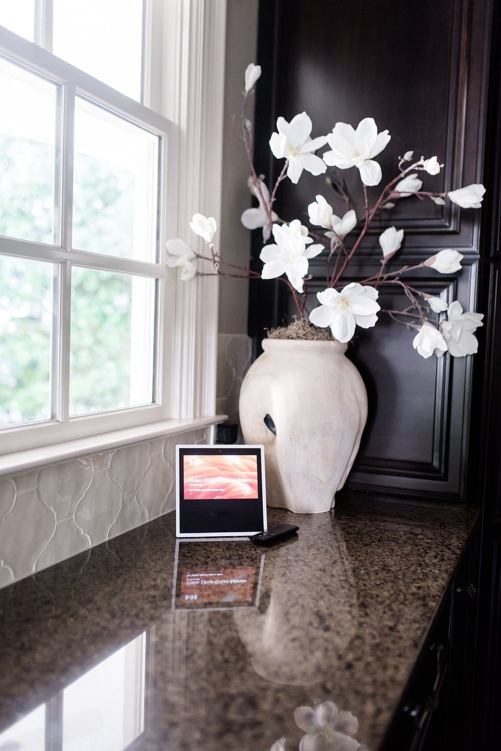 Amazon Alexa Show with wood vase and faux magnolias.