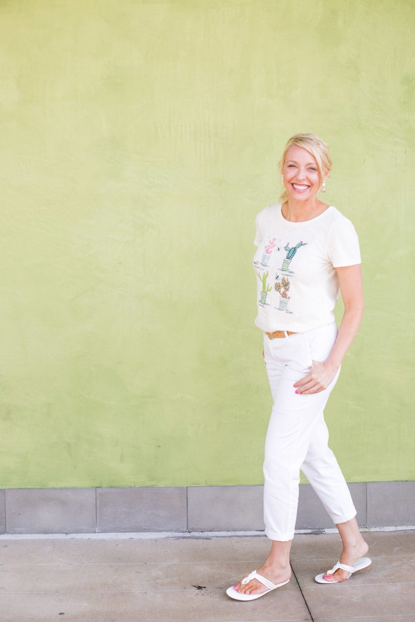 Embroidered t shirt with cactus print and summer white pants outfit.