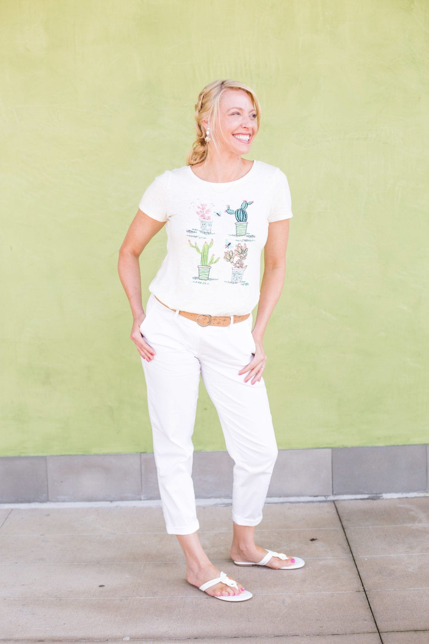 White sandals and beige belt with cactus t shirt.