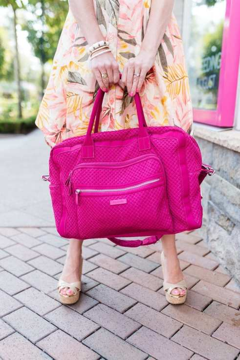 Vera Bradley Weekender Bag sale. Pink luggage with orange and yellow floral dress. Summer dress outfit on sale!