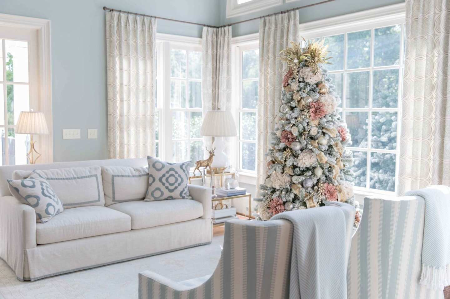 New ideas for 2018 on how to decorate a holiday tree. A pretty tree is decorated in non traditional color scheme.