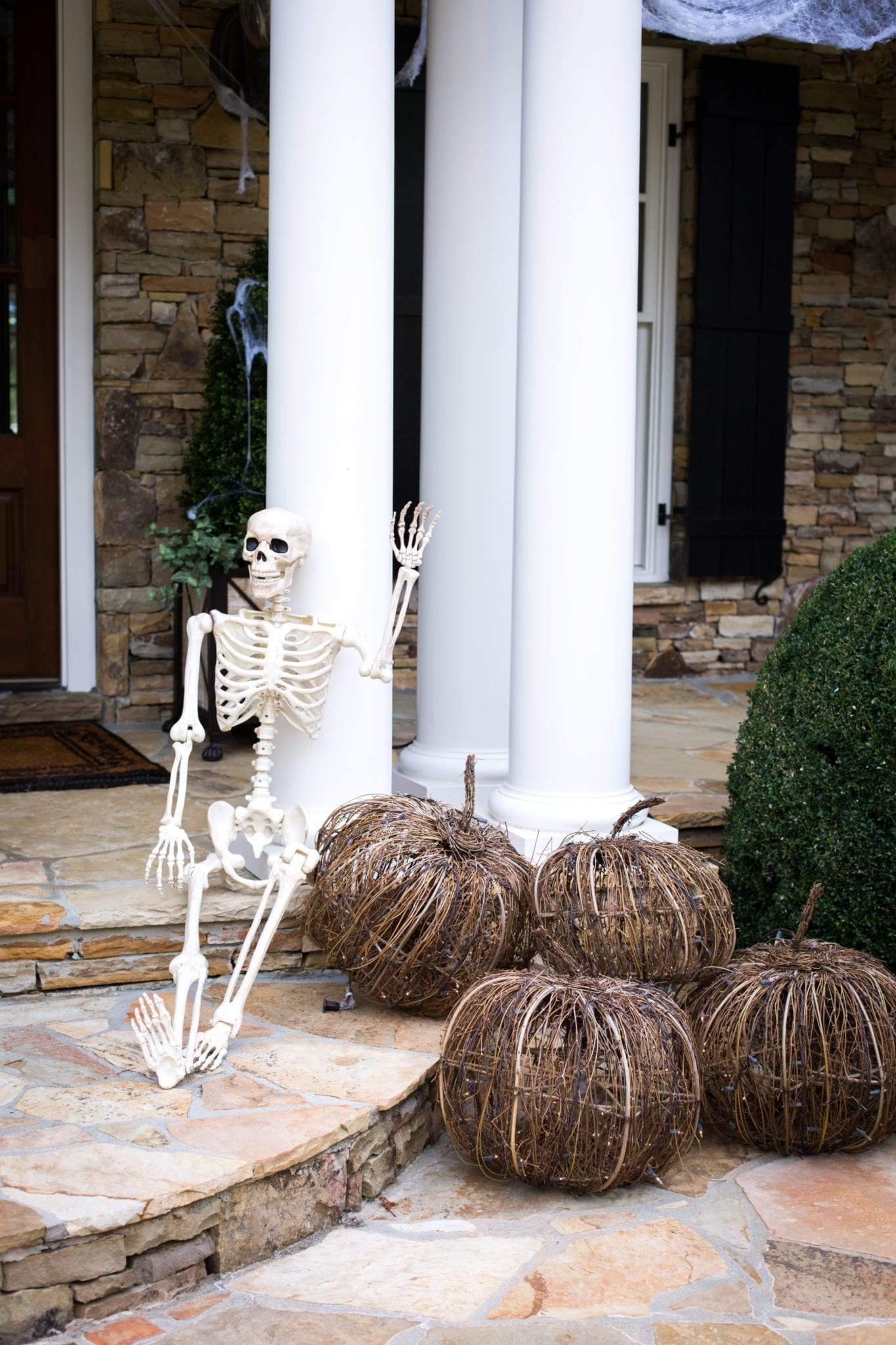Decorating outside your house for Halloween.