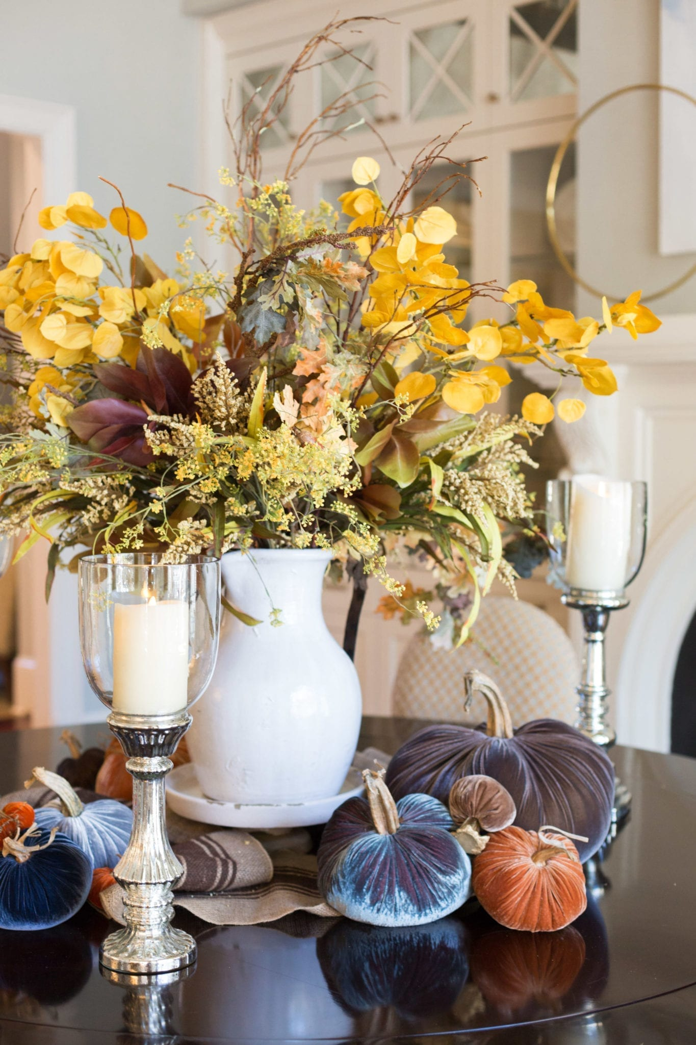 Rustic Fall Tablescape. Centerpiece with fake fall flowers in Tuscan Urn.