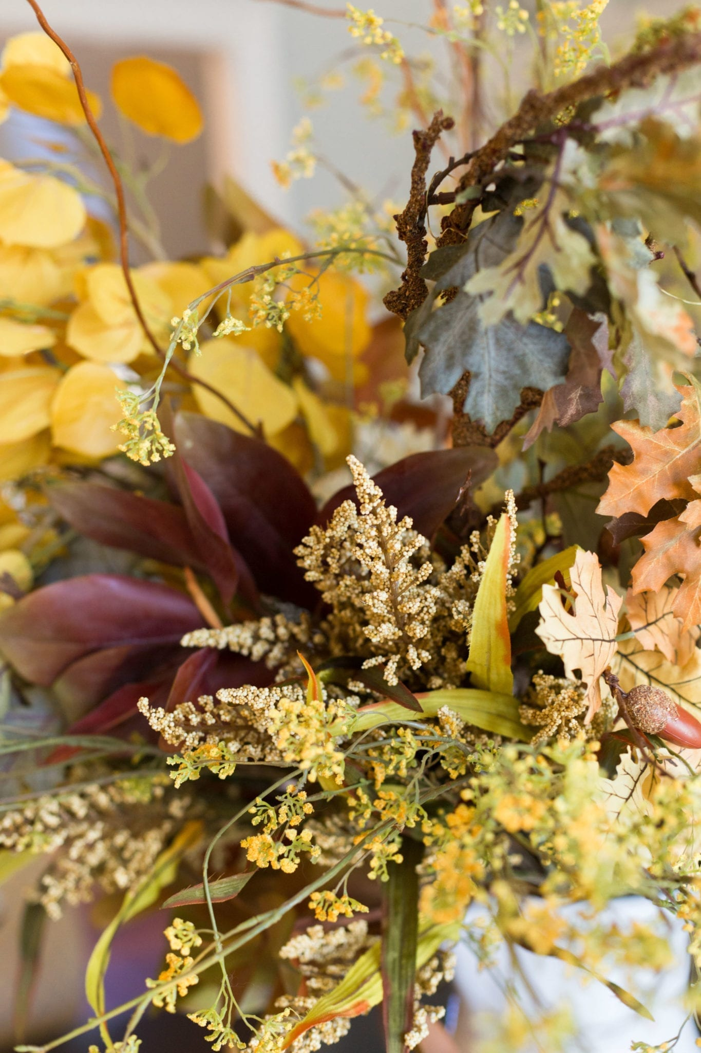 Fall flower decorations in a fall centerpiece for your dining room.