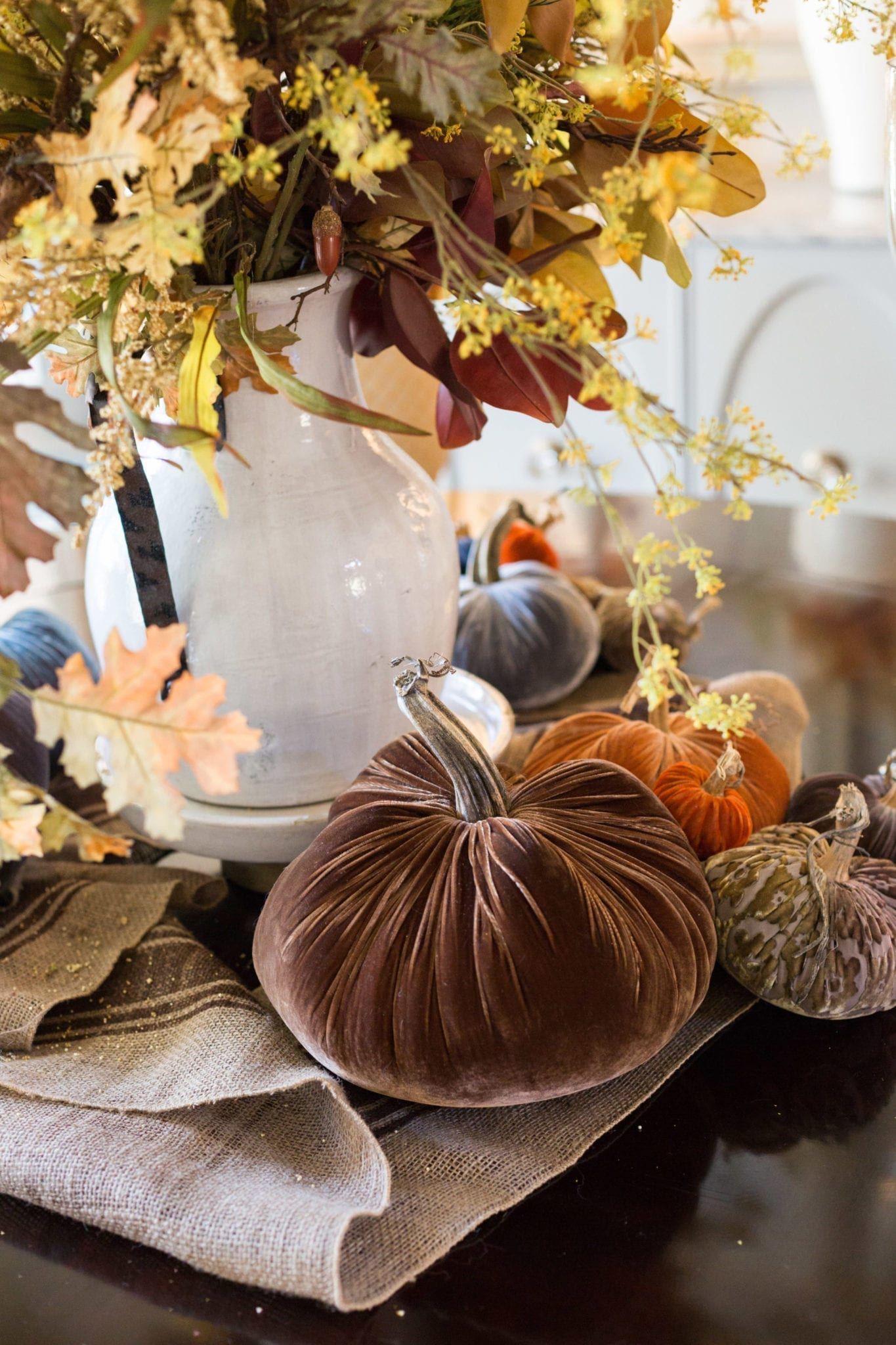 Fall velvet pumpkins. A beautiful farmhouse style table setting for Thanksgiving.