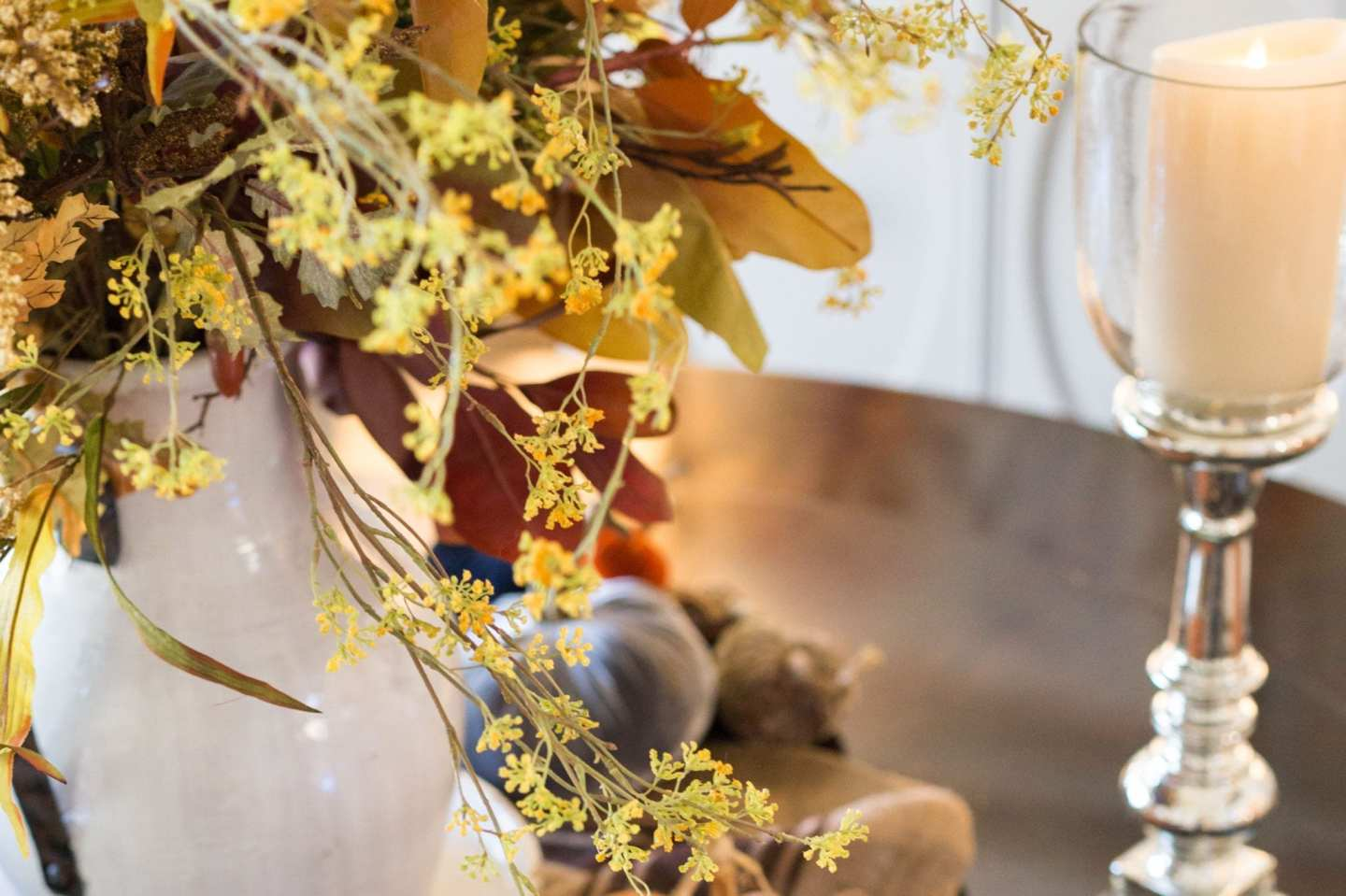 Gorgeous fall flowers and mercury glass candles.