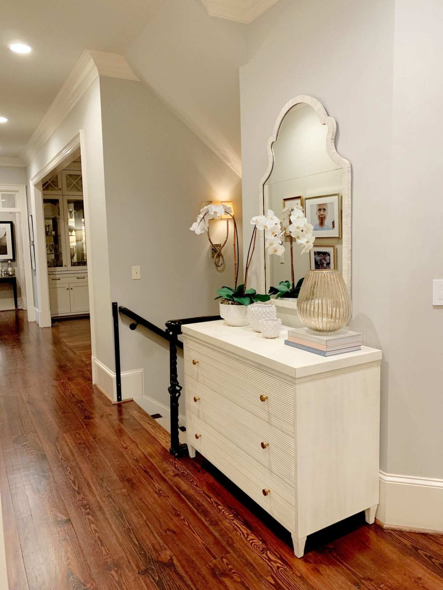 Hallway Decor. Hickory White Chest by Suzanne Kasler in hallway entryway. Ivory bone wall mirror.