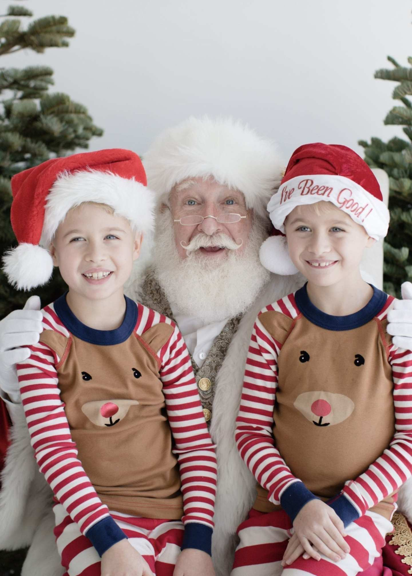 Identical twin boys in Hanna Andersson Christmas Pajamas