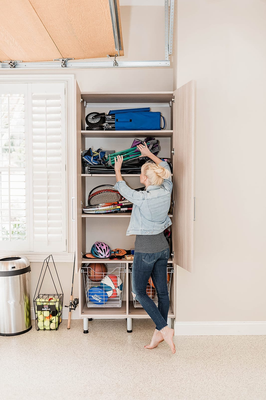 Garage organization cabinets made by California Closets. Tips for building custom cabinetry for organizing your garage.