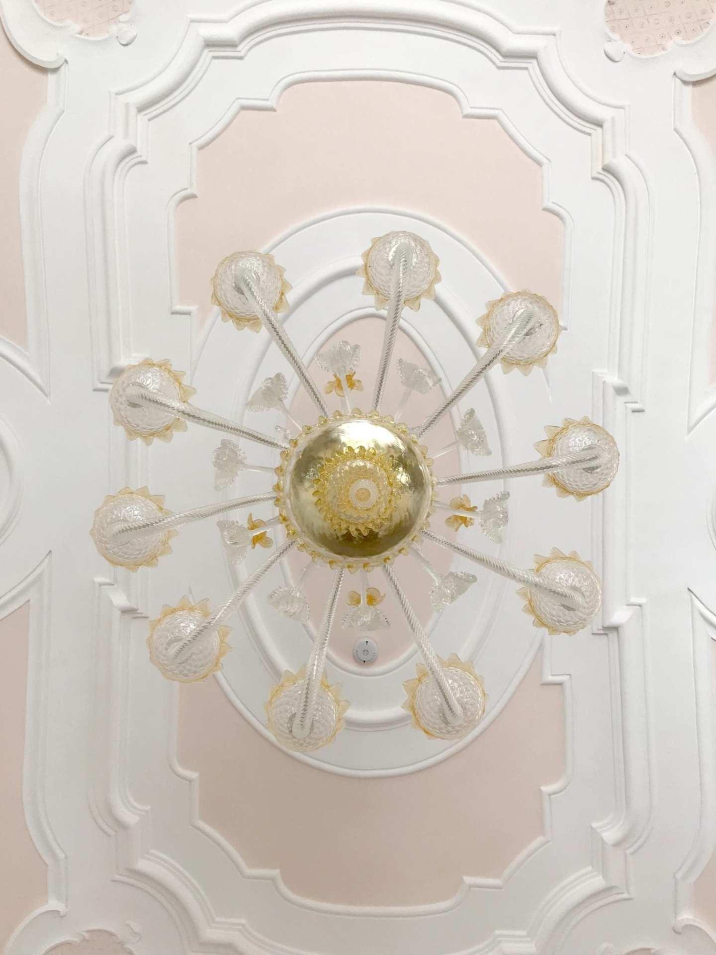 Villa Rufolo chandelier with pink ceiling.