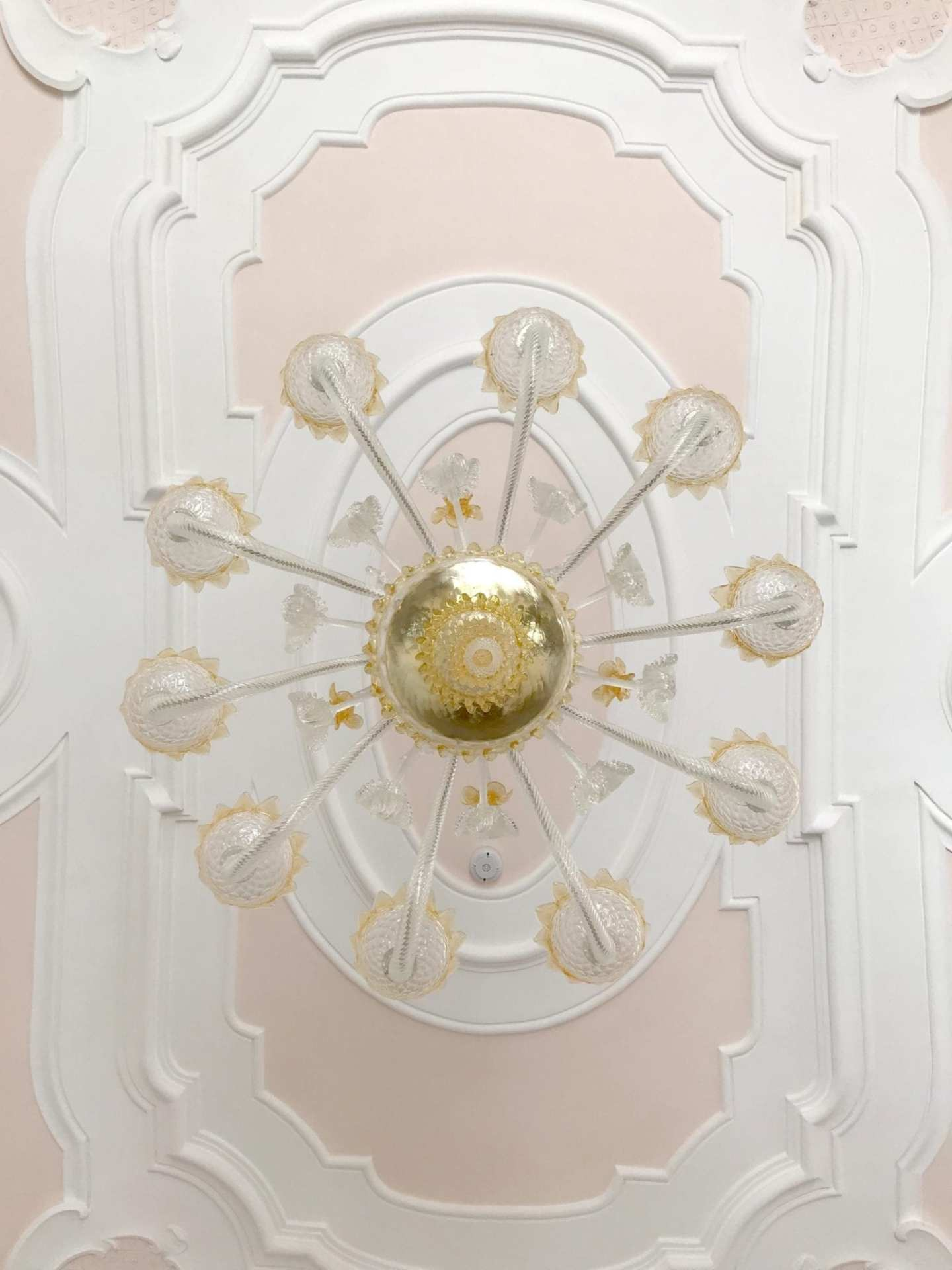 Villa Rufolo chandelier with pink ceiling.