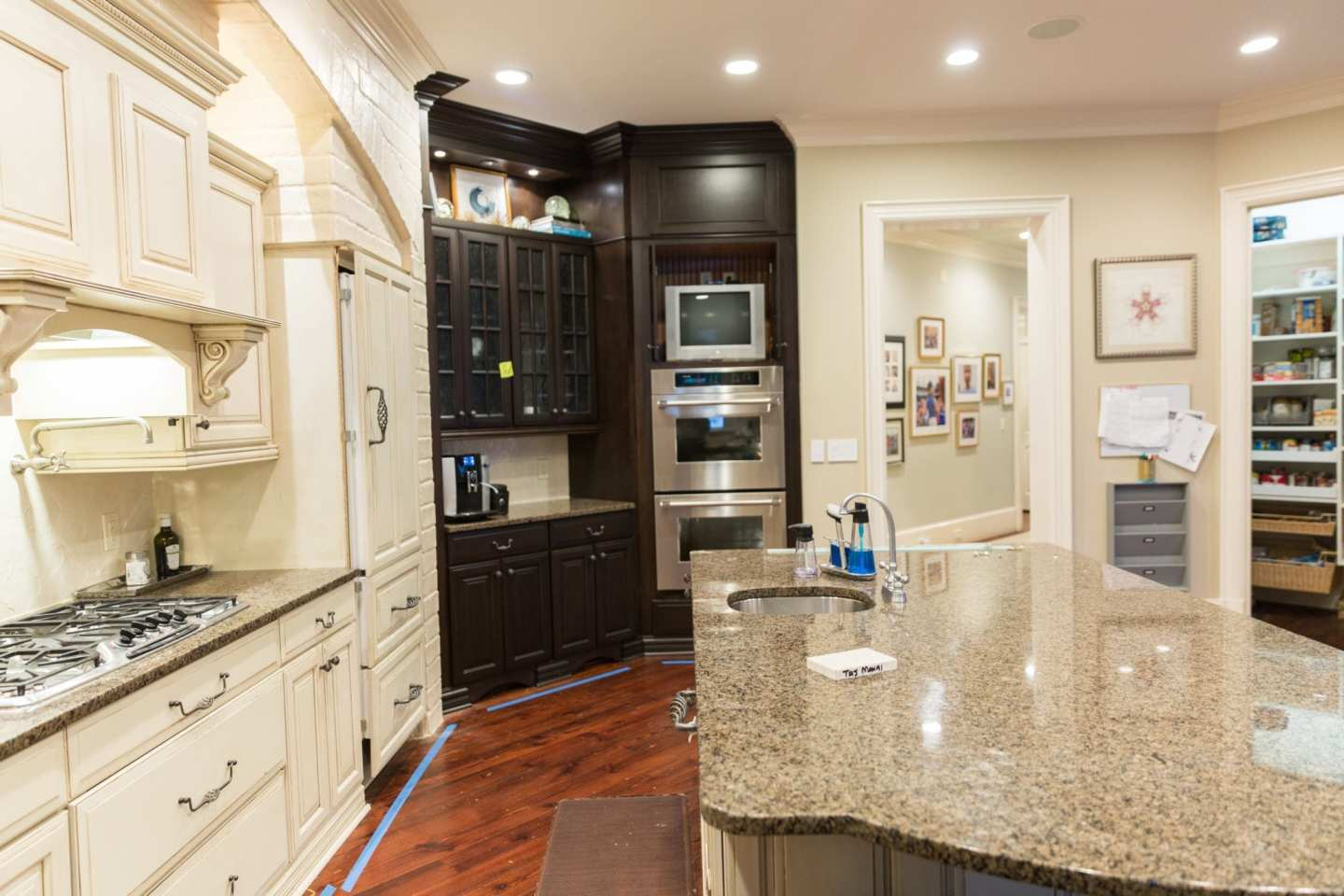 Kitchen remodel before and after. TV in kitchen with granite countertops.