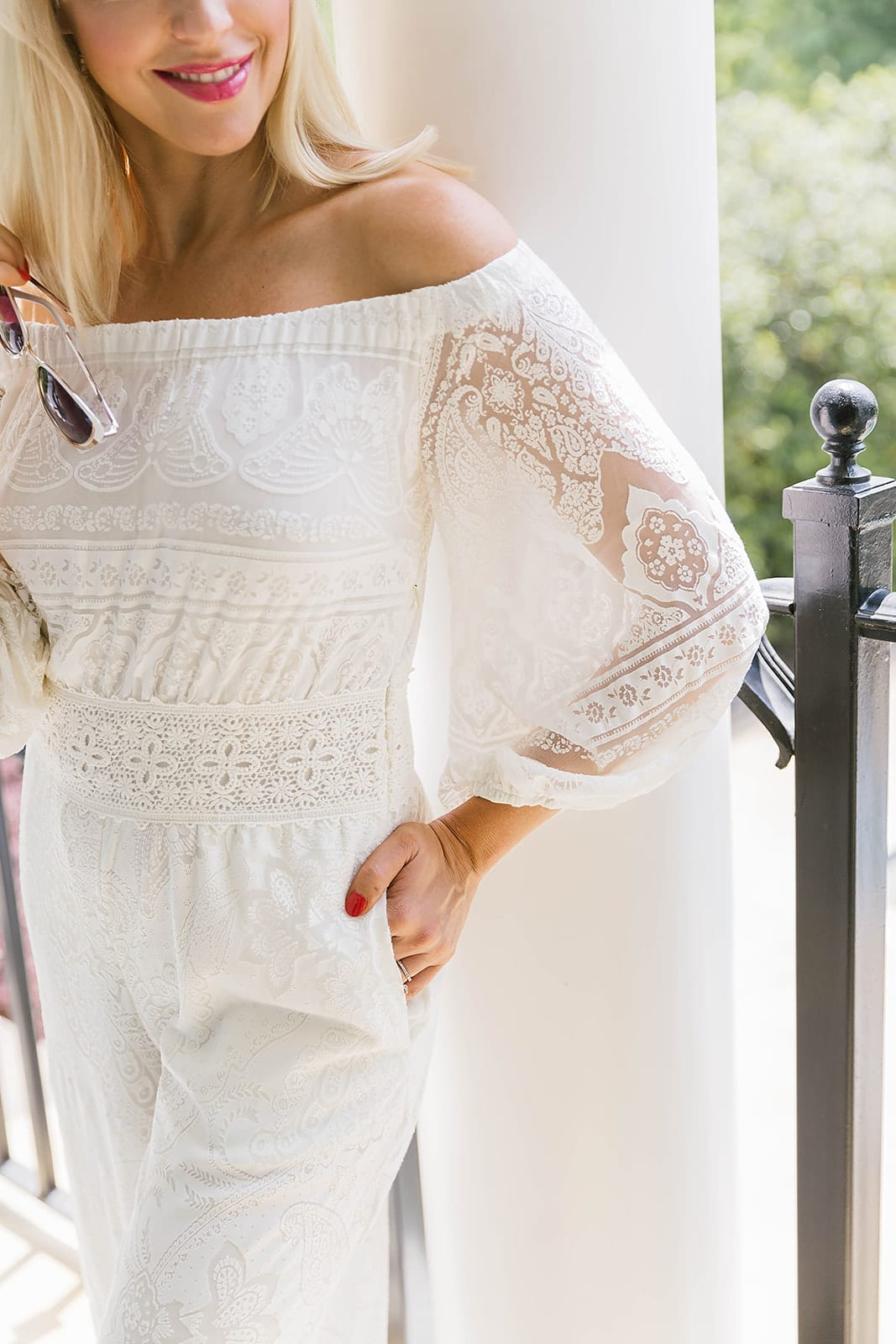 Great outfit to wear to bridal shower. White sheer lace sleeve with embroidered lace waist and all white jumpsuit with pockets.