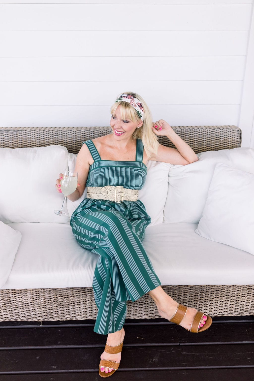 Anthropologie Headscarf in gorgeous pink and green florals. How to wear a headscarf with bangs and pair with a summer jumpsuit and brown sandals.