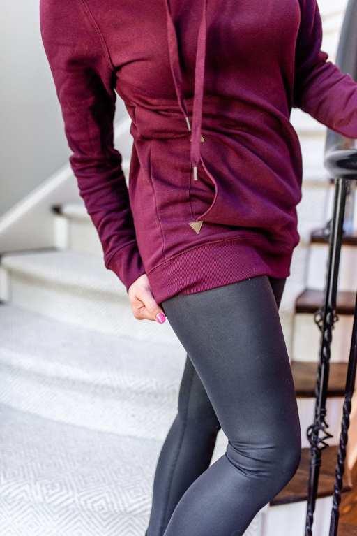 Long sweatshirt hoodie in dark maroon color with shiny yoga pants.