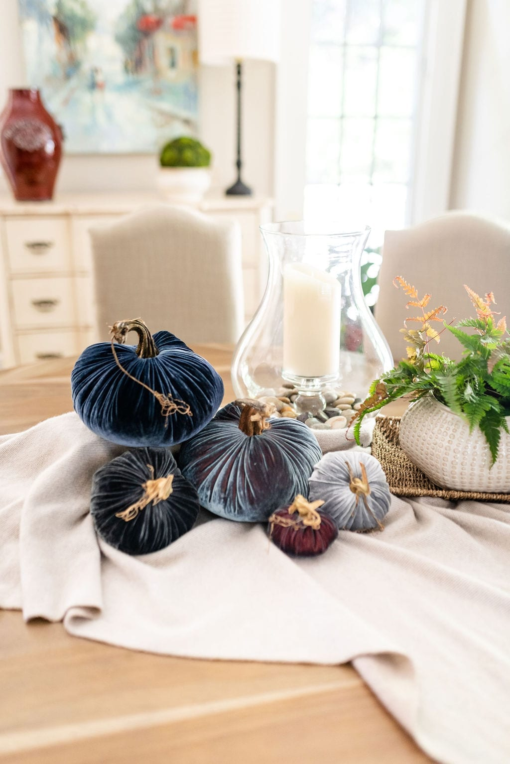 Blue Pumpkins from blogger BlueGrayGal. Plush Pumpkin in exclusive colors. Hurricane vase and simple Thanksgiving table decorating.