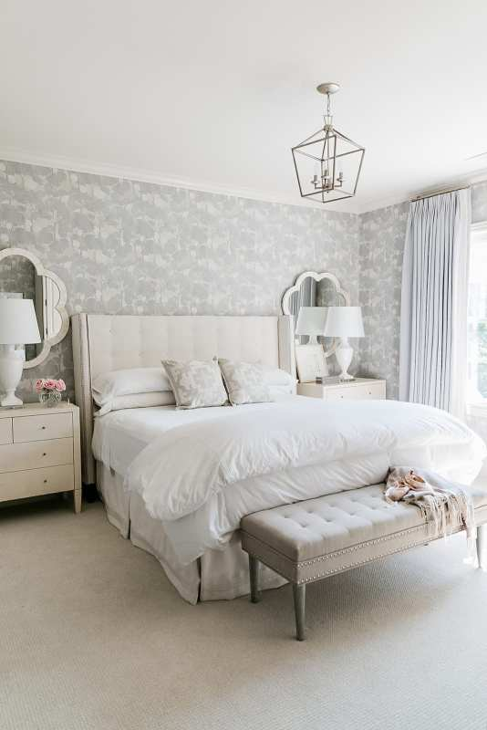 Guest bedroom makeover. Lavender floral wallpaper, white hotel sheets, Madegoods dresser and custom headboard from Calico.