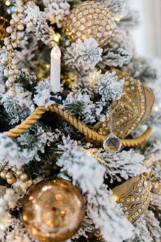 Gold Rope on Christmas Tree look like a chandelier crystal Christmas tree with crystals hanging from flocked tree.
