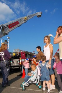 By Tommy Stafford : Members of Wintergreen Fire & Rescue show students at Rockfish River Elementary how they use a ladder truck to fight fires.
