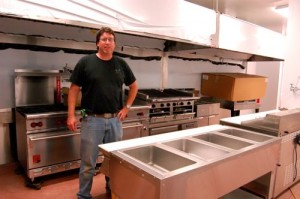 Executive Chef, Shawn Goodwin, stands in the soon to be completed kitchen of the restaurant.