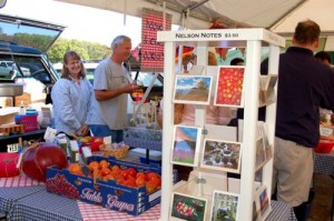 Photos By : Tommy Stafford : Anita & Tom Weber talk to customers at the last official Farmers Market for 2008