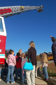 Students check out the new ladder truck used by Wintergreen.
