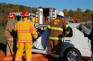 Members of the Lovingston Volunteer Fire Department demonstrate how they get injured people out of a car wreck.