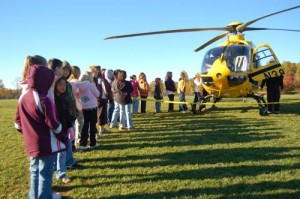 Students line up for a chance to look inside Air Care-5.
