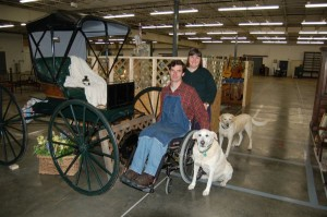 Larry Whitaker, Judy Barnes and Boo, (front dog) in an NCL picture from the Blue Moon Antique Mall opening in 2006.