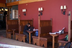 Photos Courtesy DBBC : A food service rep sits in one of the recently completed booths at Devils Backbone Brewery