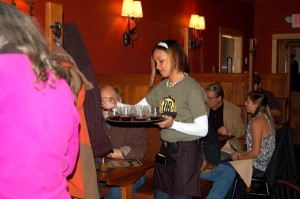 A DBBC waitress brings out a sampler tray of the microbrews at Nelson's newest brewery and restaurant.