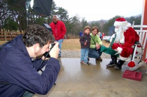 Photo By Tommy Stafford : ©2008 NCL : Pro photographer, Ben Hernandez, snaps a child visiting Santa at MountainSide Petting Farm in Afton, Virginia