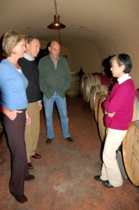 ©NCL Magazine 2009 : New owners Tony & Elizabeth (left) look over the underground barrel room with Tom and Shinko.