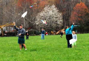 By Ann Strober : Several parents and youngsters launch their kites over Spruce Creek Saturday afternoon.