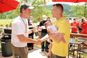 Woody Elliot, the coordinator of The Devils Backbone Challenge, hands out awards after the race.