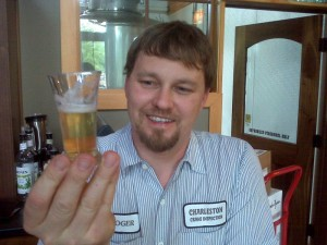 ©2009 NCL Magazine : Devils Backbone Brewmaster Jason Oliver holds up a sample of his latest beer creation.