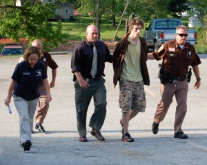 © 2009 Nelson County life Magazine. Photo by Tommy Stafford. 20 year-old Austin Griffin is led to a bond hearing by Sheriff David Brooks.(right) Inv. Becky Adcock, Capt. Ron Roberson, and Inv. Paul McCormick accompany Griffin.
