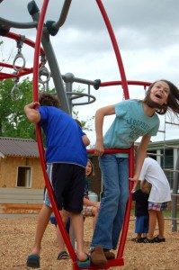 Youngsters play on one of the many pieces of playground equipment now installed at RVCC just north of Nellysford, Virginia.