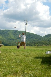 A father and son toss a football at the winery on Saturday.
